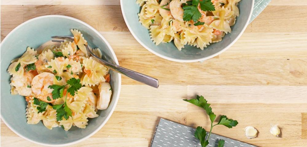 Pasta, scampi's, tomaten, peterselie, knoflook